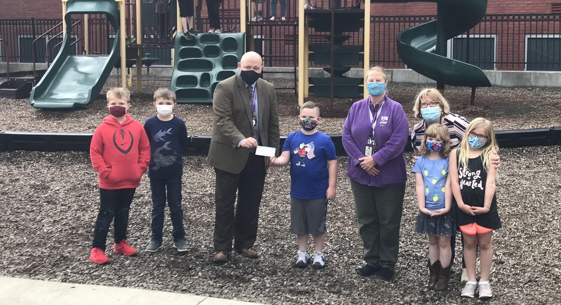 Mrs. Lapehn's 1st Grade students @ BEE presenting Mr. Ondrus a check from BEE PTA to Esther Ryan shoe fund. The students raised $258.00 in their box top drive. Mrs. Lapehn's class turned in the highest number of box tops.